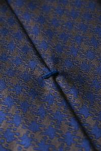 Cravate en soie bleu/cuivre à motifs triangles